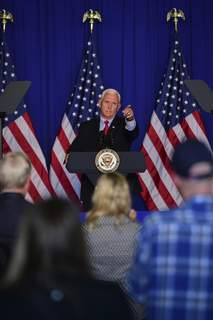 Mike Moore | The Journal Gazette Vice President Mike Pence speaks at a campaign rally Thursday inside a hangar at the Aero Center at Fort Wayne International Airport.