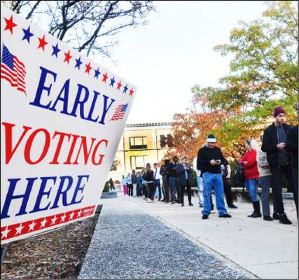 File Early voters wait in line in November 2016 outside the Rousseau Center downtown. Four satellite voting sites, including the Rousseau Center, open Monday.