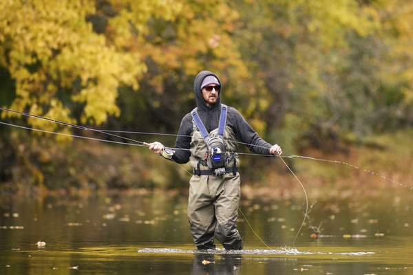 Mike Moore   The Journal Gazette Unafraid of getting his feet wet on Tuesday, Reed Nichoson fishes for Pike in Cedar Creek near Leo-Cedarville.