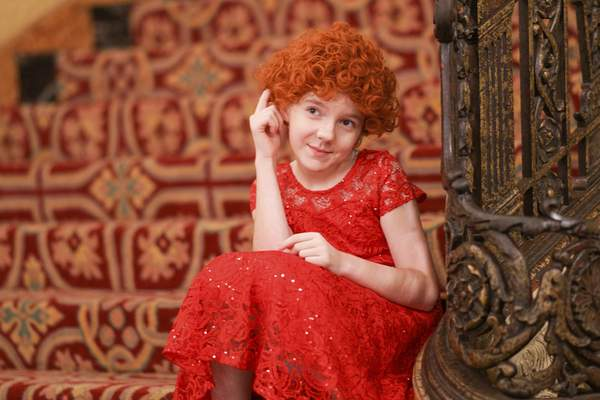 Mike Moore   The Journal Gazette  Avery Garrett as Annie posing at the Embassy Theatre on Tuesday for the Civic Theatre's production of Annie, which opens Nov. 3.
