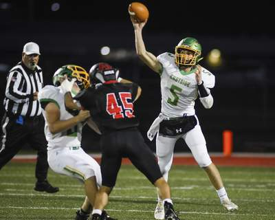 Mike Moore | The Journal Gazette Eastside quarterback Laban Davis passes the ball in the first quarter against Bluffton at Bluffton High School on Friday.