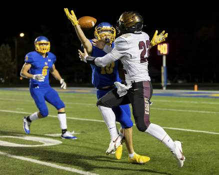 Josh Gales | The Journal Gazette East Noble junior Damien Williams defends a pass intended for Columbia City senior TJ Bedwell during the second quarter Friday. The pass was intercepted by East Noble junior Rowan Zolman, who's in the background.
