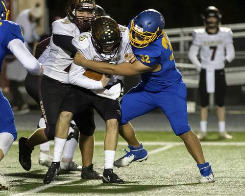 Josh Gales   Journal Gazette East Noble sophomore Hunter Pfeiffer sacks Columbia City junior Gregory Bolt during the second quarter of the sectional game at East Noble High School on Friday.