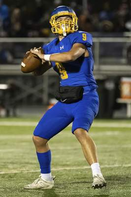 Josh Gales   Journal Gazette East Noble senior Cole Schupbach looks for an open receiver during the first quarter of the sectional game at East Noble High School on Friday.