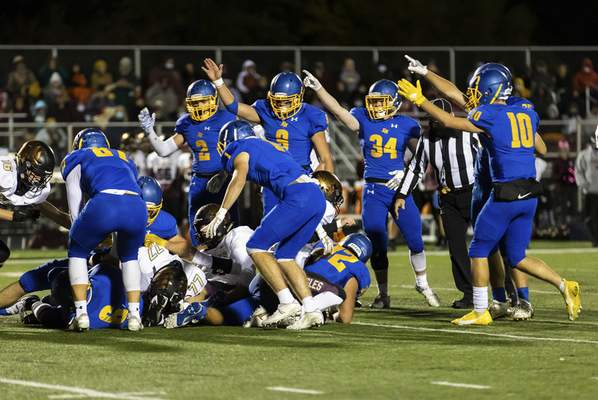 Josh Gales   Journal Gazette The East Noble defense reacts to a fumble recovery during the second quarter of the sectional game at East Noble High School on Friday.