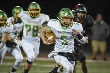 Mike Moore   The Journal Gazette Eastside quarterback Laban Davis carries the ball in the second quarter Friday night against Bluffton.