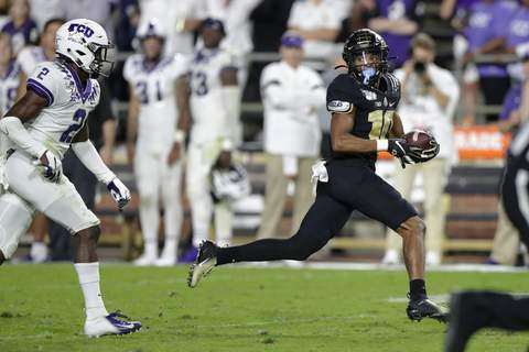 TCU Purdue Football Associated Press Purdue wide receiver Amad Anderson, right, is hoping to help the Boilermakers sprint to a good start today despite the team being short-handed. (Michael ConroySTF)