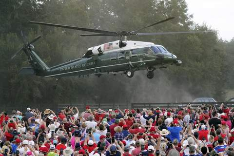 APTOPIX Election 2020 Trump Associated Press photos President Donald Trump arrives in the Marine One helicopter for a campaign rally as supporters cheer Friday in The Villages, Fla. (John RaouxSTF)