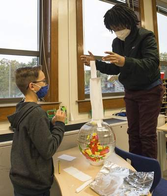 Michelle Davies | The Journal Gazette Braxton Davis, left, and Benjamin Davis, students in Chris Lechleitner's fifth-grade class at Irwin Elementary School, work on a STEM project using engineering design processes to build a tower on a round surface.