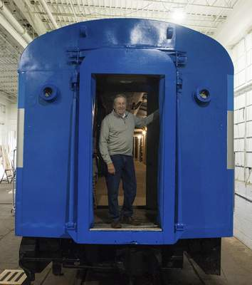 Michelle Davies | The Journal Gazette Don Steininger, president of Headwaters Junction, stands in the former hospital train car that is being converted to a club car.