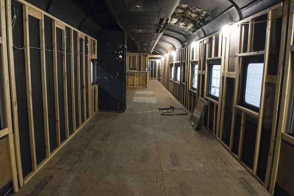 Photos by Michelle Davies | The Journal Gazette The interior of a train club car, which was a hospital train car, is being worked on. After completion, it will be placed in Headwaters Junction.