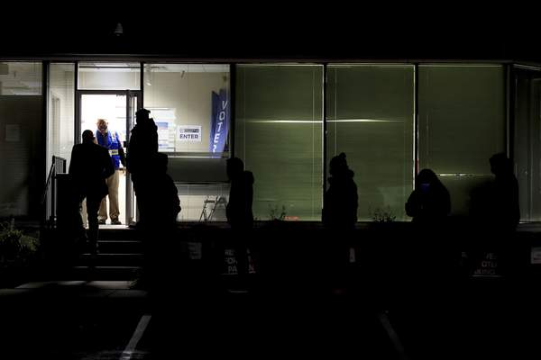 People stand in line at the Hamilton County Board of Elections as they wait to vote, Tuesday, Nov. 3, 2020, in Norwood, Ohio. (AP Photo/Aaron Doster)