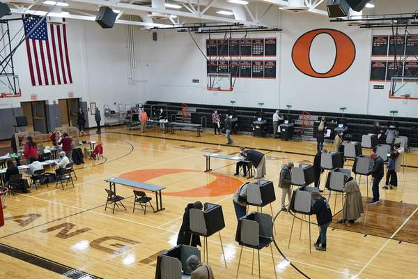 Voters cast their ballots on Election Day at Orange High School in Pepper Pike, Ohio, Tuesday, Nov. 3, 2020. (AP Photo/Tony Dejak)