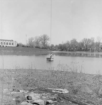 April 28, 1967: Bonn B. Hill is seen fishing from the bucket of a crane at the confluence of the city's rivers. The water filtration plant can be seen in the background. (Journal Gazette File photo)