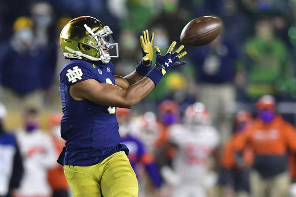 Notre Dame wide receiver Avery Davis catches a fourth-quarter pass against Clemson in an NCAA college football game Saturday, Nov. 7, 2020, in South Bend, Ind. (Matt Cashore/Pool Photo via AP)