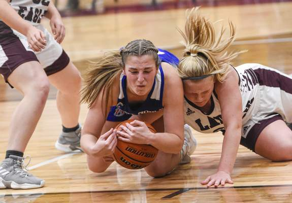 Mike Moore | The Journal Gazette  West Noble forward Nichelle Phares, left and Columbia City forward Kamrin Parker dive for a loose ball in the first period at Columbia City on Tuesday.
