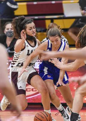 Mike Moore | The Journal Gazette Columbia City guard Anna Schrader, left pressures West Noble guard Mackensy Mabie in the first period at Columbia City on Tuesday.