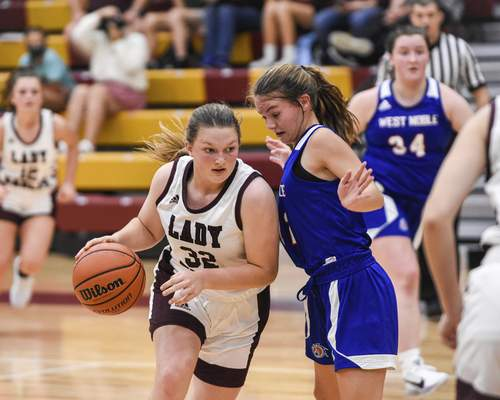 Mike Moore | The Journal Gazette  West Noble guard Mackensy Mabie, right pressures Columbia City guard Brooke Lickey in the second period at Columbia City on Tuesday.