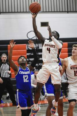 Mike Moore | The Journal Gazette Indiana Tech guard Cory McKinney takes a jump shot in the first half against Saint Francis at the Schaefer Center on Wednesday