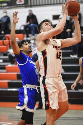 Mike Moore | The Journal Gazette Indiana Tech forward Josh Kline goes up under the basket in the first half against Saint Francis at the Schaefer Center on Wednesday