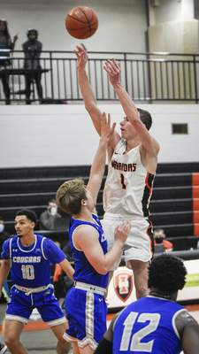 Mike Moore | The Journal Gazette Indiana Tech guard Grant Smith takes a shot at the basket in the first half against Saint Francis at the Schaefer Center on Wednesday
