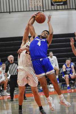 Mike Moore | The Journal Gazette Saint Francis guard Lance Dollison comes down with a rebound in the first half against Indiana Tech at the Schaefer Center on Wednesday