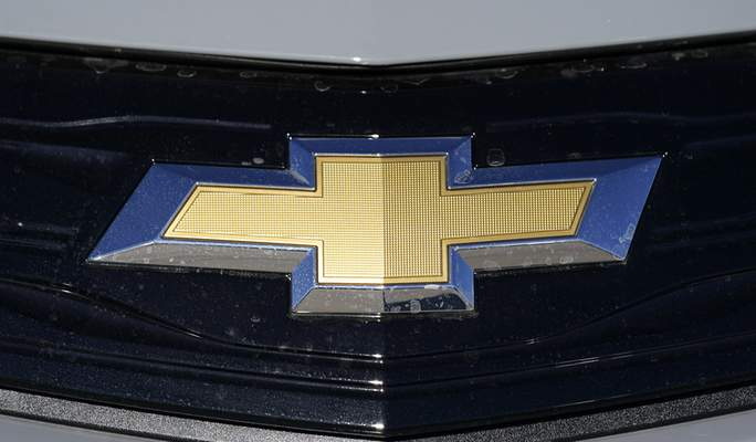 The Chevrolet logo is displayed at a Chevrolet dealership Sunday, Nov. 8, 2020, in Englewood, Colo. General Motors says it will recall nearly 69,000 Chevrolet Bolt electric cars worldwide because the batteries have caught fire in five of them. (AP Photo/David Zalubowski, File)