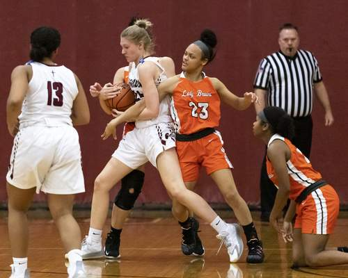 Rachel Bellwood   The Journal Gazette Concordia's Annaka Nelson fights for the ball during the first quarter Saturday against Northrop. Nelson scored a game-high 26 points.