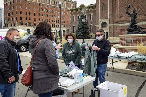 Mike Moore | The Journal Gazette Volunteers and CTN staff members  register guests for Saturday's fifth annual Hop On Brew Tour, which raised about $22,000 for the nonprofit.