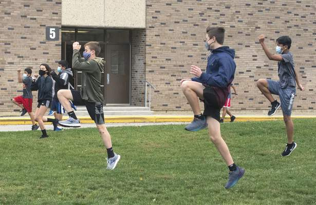 Michelle Davies | The Journal Gazette Members of Lakeside Middle School's cross country intramural group go through warm-up drills during practice.