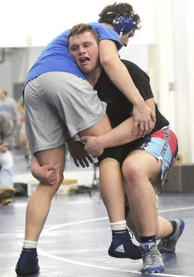 Katie Fyfe   The Journal Gazette Carroll senior Reeve Muncie, right, earned three victories at Bankers Life Fieldhouse to finish fifth in the state at 285 pounds. He enters the season as the 13th-ranked senior wrestler – regardless of weight class – according to IndianaMat.com.