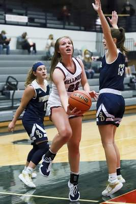 Rachel Bellwood | The Journal Gazette  Bellmont's Kenzie Fuellinggoes in for a layup against Bishop Dwenger during first quarteroftheirgirls basketball gameatBellmont on Tuesday.