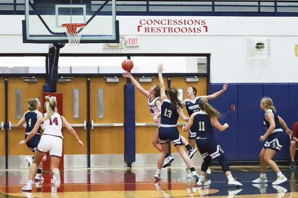 Rachel Bellwood | The Journal Gazette Bellmont's Kenzie Fuelling shoots the ball in the second quarter during girls basketball game was hosted by Bellmont High School on Tuesday night.