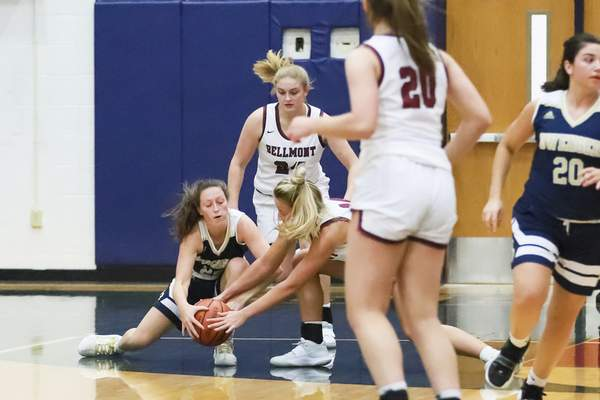 Rachel Bellwood | The Journal Gazette  Bishop Dwenger's Victoria Parent fights Bellmont's Morgan Shifferly for the ball in the second quarter during their girls basketball game at Bellmont on Tuesday.