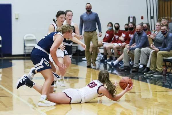 Rachel Bellwood | The Journal Gazette  Bellmont's Kenzie Fuelling dives for the ball and then passes to teammate Lauren Bleke during first quarteragainst Bishop Dwengeroftheirgirls basketball gameatBellmont on Tuesday.