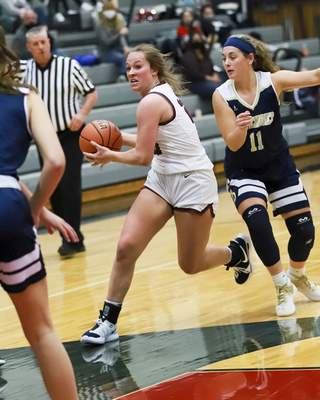 Rachel Bellwood | The Journal Gazette  Bellmont's Kenzie Fuelling charges to the basketagainst Bishop Dwenger duringtheirgirls basketball gameatBellmont on Tuesday.