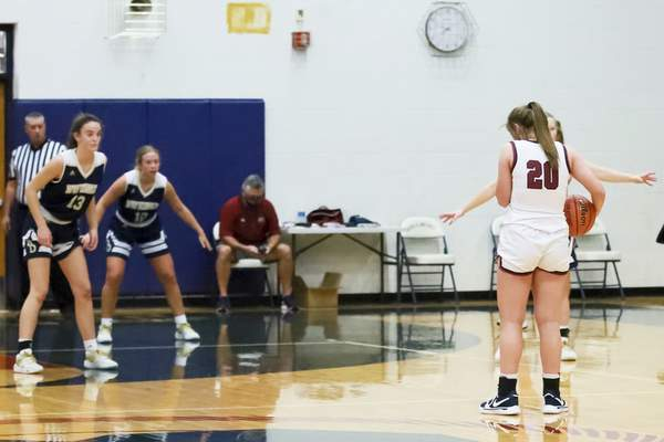 Rachel Bellwood | The Journal Gazette A strange moment to the start of the second quarter of the girls basketball game when Bellmont's Kenzie Fuelling holds the ball (ask Vicky?). The game was hosted by Bellmont High School onTuesday night..