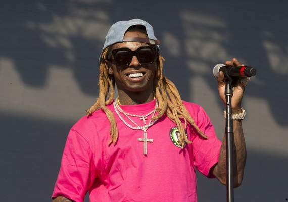 FILE - In this June 16, 2018, file photo, Lil Wayne performs on Day 3 of the 2018 Firefly Music Festival at The Woodlands in Dover, Del. Rapper Lil Wayne has been charged with possession of a firearm by a convicted felon, an offense that carries a potential sentence of up to 10 years in prison. (Photo by Owen Sweeney/Invision/AP, File)