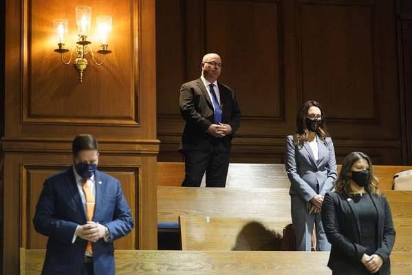 Associated Press Rep. Curt Nisly, R-Milford, top, listens without a mask Tuesday during Organization Day at the Statehouse in Indianapolis.