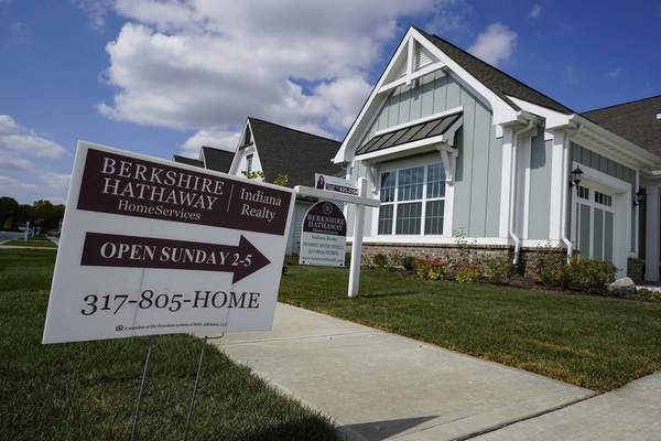 An open house is posted in front of a home for sale in Westfield, Ind., Friday, Sept. 25, 2020. Sales of existing homes rose for a fifth straight month in October, the National Association of Realtors said Thursday, Nov. 19. Existing homes sales rose 4.3% to an seasonally-adjusted rate of 6.85 million annualized units. (AP Photo/Michael Conroy)