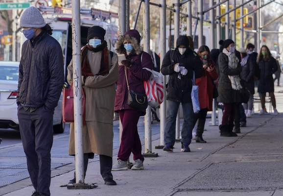 Associated Press People wait in a line stretching around a block Wednesday outside an urgent care clinic offering COVID-19 testing in the Brooklyn borough of New York.