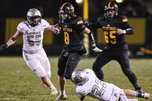 Mike Moore | The Journal Gazette South Adams wide receiver Trey Schoch breaks a tackle in the first quarter of the Semi-State championship against Lafayette Central Catholic in Berne on Friday.