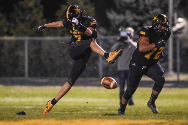 Mike Moore | The Journal Gazette South Adams kicker Aidan Wanner kicks the ball in the first quarter of the Semi-State championship against Lafayette Central Catholic in Berne on Friday.
