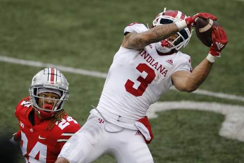 APTOPIX Indiana Ohio St Football Indiana receiver Ty Fryfogle, right, catches a pass for a touchdown over Ohio State defensive back Shaun Wade during the second half of an NCAA college football game Saturday, Nov. 21, 2020, in Columbus, Ohio. Ohio State beat Indiana 42-35. (AP Photo/Jay LaPrete) (Jay LaPrete FRE)