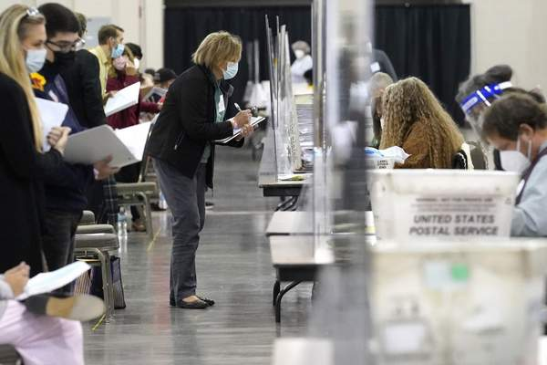 Associated Press Recount observers watch ballots during a hand recount of presidential votes Friday at the Wisconsin Center in Milwaukee.