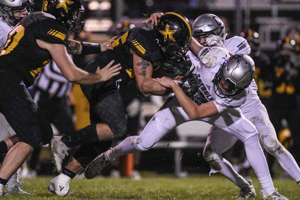 Mike Moore | The Journal Gazette South Adams running back Christian Summersett has 21 carries for 130 yards in the Starfires' Class 1A semistate victory Friday night over Lafayette Central Catholic. South Adams earned its first-ever berth in the state championship game.