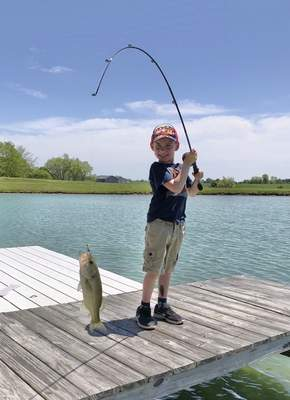 Courtesy photos When Clay Johnson was 5, he caught  his first largemouth bass entirely by himself,  May 24 in Huntington County.