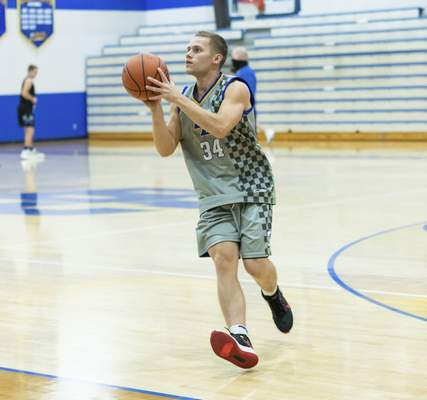 Rachel Bellwood | The Journal Gazette Marcus Davidson practicing catch and shoot drills with his team at Blackhawk Christian School on Monday night.