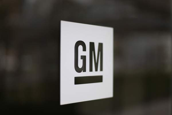 FILE - This Friday, May 16, 2014, file photo, shows the General Motors logo at the company's world headquarters in Detroit. (AP Photo/Paul Sancya, File)