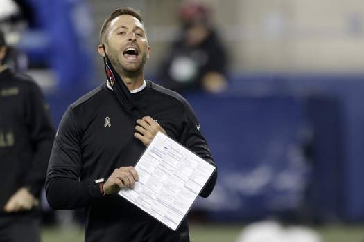 Cardinals Seahawks Football Associated Press Cardinals coach Kliff Kingsbury removes his mask to yell before Thursday's game. Under new guidelines, he'll have to keep it on. (Lindsey WassonFRE)
